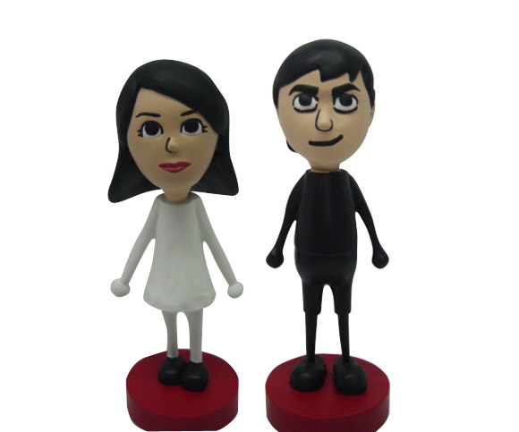 CustomBobble.com can make Mii Bobble head cake-toppers in your likeness for $185