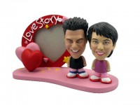 Teen Couple with Heart Frame Bobbleheads
