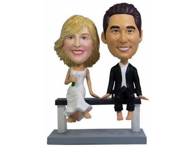 Wedding Couple Bobbleheads sitting on a bench